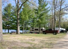 View of Trees and Lake with Camper and Truck